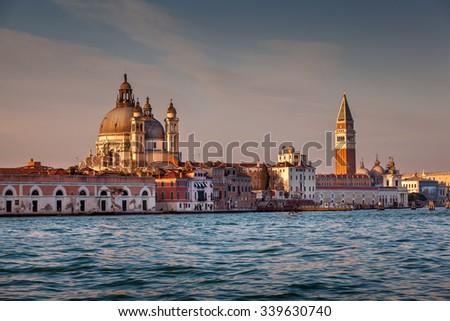 Santa Maria della Salute Church and Saint Mark's Campanile in the Evening, Venice, Italy - stock photo