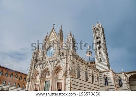 Santa Maria della Scala church located in Siena, Tuscany, Italy. - stock photo