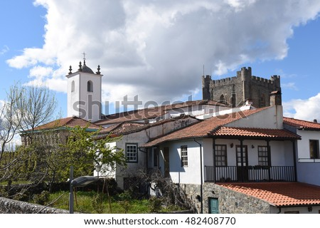 Santa Maria do Castelo, Church and tower in the castle in the background. Braganca, Braganca District, Norte Region, Portugal, Europe