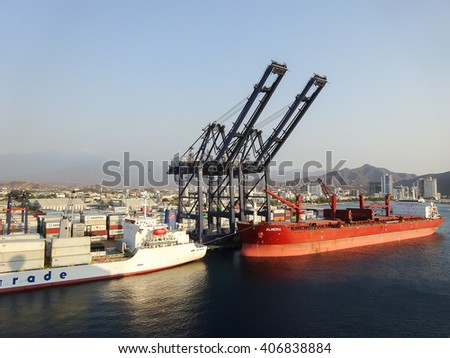 SANTA MARTA, COLOMBIA : MARCH 23, 2016 : Harbor view with container ships in port of Santa Marta in Colombia on March 23th, 2016.