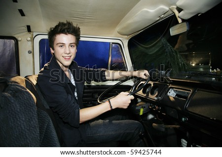 "SANTA MONICA, CA - AUGUST 20: Sterling Beaumon (15), who played Young Ben, at the Profiles in History auction of ABC's ""Lost"" on August 20, 2010 in Santa Monica, CA. Beaumon in the DHARMA van."