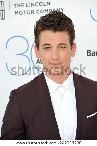 SANTA MONICA, CA - FEBRUARY 21, 2015: Miles Teller at the 30th Annual Film Independent Spirit Awards on the beach in Santa Monica.  - stock photo
