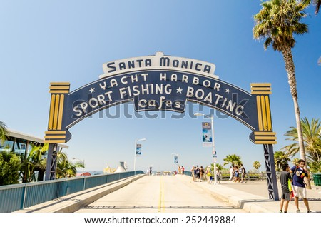 SANTA MONICA, CALIFORNIA - AUGUST 29: The welcoming arch of Santa Monica Pier on August 29, 2012. The site is an iconic 100-year-old landmark for California visitors. - stock photo