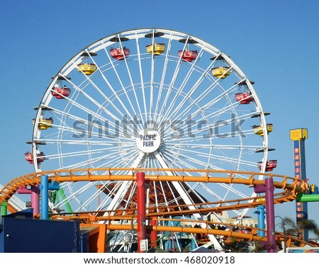 SANTA MONICA, CALIFORNIA - JUL 18: Santa Monica pier Pacific Park oceanfront amusement park's Ferris wheel is the world's first and only solar powered Ferris wheel. Santa Monica Jul 18, 2016.