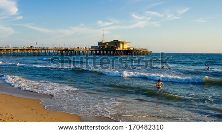 SANTA MONICA, CALIFORNIA - SEPTEMBER 8: Santa Monica beach on September 8, 2012 in Santa Monica, California. The city has 3.5 miles of beach locations and averages 340 days of sunshine every year. - stock photo