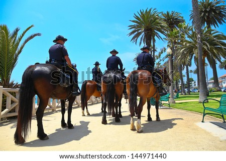 SANTA MONICA, CALIFORNIA, USA - JULY 4, 2013: Santa Monica Police Department patrols Santa Monica recreational park providing security on Independence Day on July 4, 2013 in Santa Monica, California. - stock photo