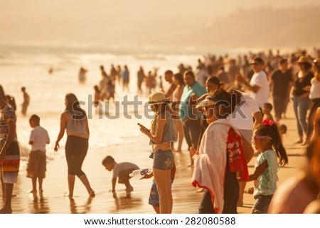 SANTA MONICA, CALIFORNIA/USA - MAY 24, 2015. Crowds gathered to sunbathe and swim at the Santa Monica State Beach near the Santa Monica Pier. - stock photo