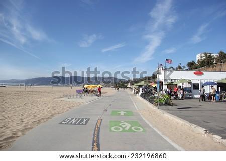 Santa Monica, California, USA - November 16, 2014: Beautiful scenery of Santa Monica Beach with bicycle lane for cyclists. - stock photo