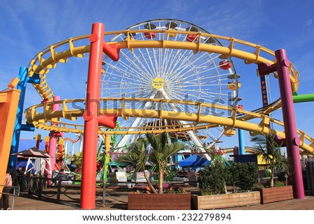 Santa Monica, California, USA - November 16, 2014: Pacific Park, with the world's only solar powered Ferris wheel, is the only amusement park located on a pier on the west coast of USA.