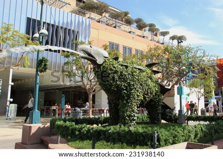Santa Monica, California, USA - November 16, 2014: The Third Street Promenade is a premium shopping, dining and entertainment district in the downtown area of Santa Monica, California.  - stock photo