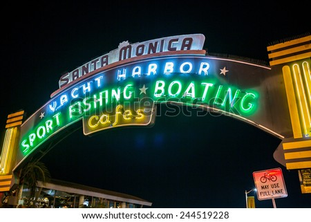 SANTA MONICA - JAN 14, 2015: Entrance Sign to Santa Monica Pier on Ocean Avenue in LA California at Night. Santa Monica is a beachfront city in Los Angeles California. - stock photo