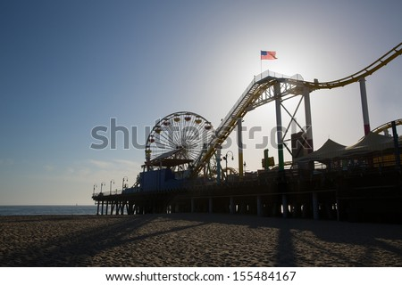 Santa Monica pier Ferris Wheel at sunset in California USA