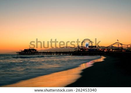 Santa Monica Pier on beach in Los Angeles - stock photo