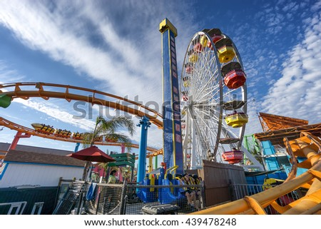 SANTA MONICA, USA - JUNE 19: The amusement park on the Santa Monica Pier, Los Angeles California on June 19, 2016. The pier is popular as a landmark that is over 100 years old - stock photo