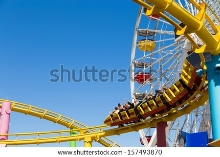 SANTA MONICA, USA - SEP 18: The amusement park on the Santa Monica Pier in Santa Monica, California on September 18, 2013. The pier is a more than hundred-year-old historic landmark. - stock photo