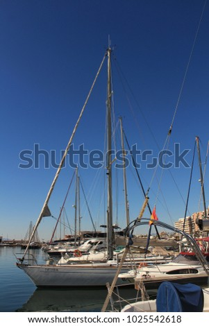 Santa Pola, Spain- 15 February, 2018: Recreational boats moored at the dock in the nautical club of Santa Pola in a sunny day