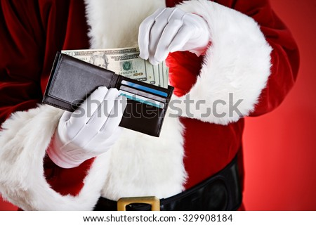 Santa: Pulling Cash Out Of Wallet - stock photo