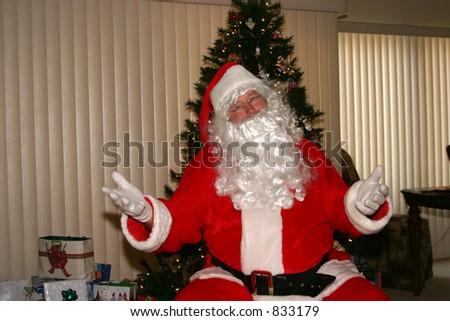 Santa relaxes by a xmas tree - stock photo