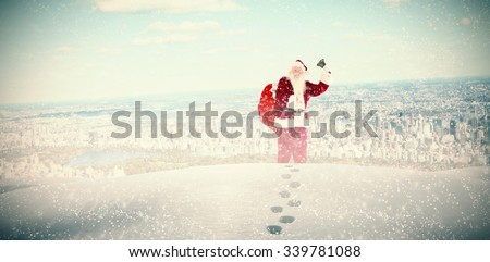 Santa ringing his bell against new york - stock photo