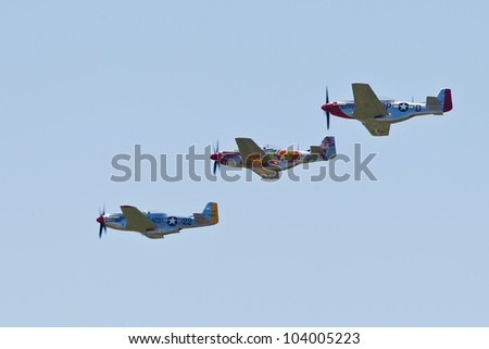 SANTA ROSA, CA - AUG 21: North American Aviation P-51D Mustang aircrafts fly in formation during the Wings Over Wine Country Air Show, on August 21, 2011, Santa Rosa, CA.