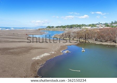 Santa Rosa Creek Estuary wetlands next to Moonstone Beach & Shamel Park, with seaside cottages in the distant background, along Big Sur Coast, California Central Coast, near Cambria CA. - stock photo