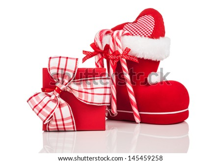 Santa's Boot, candy canes and red Christmas gift box on white background - stock photo