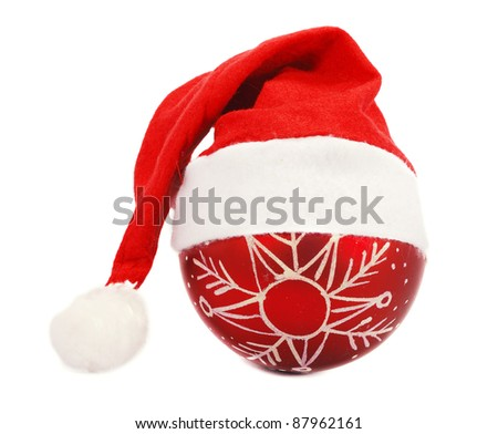 Santa's christmas hat and Christmas ball on a white background - stock photo