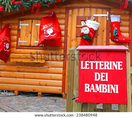Santa's cottage with the red mailbox to post the letters of children - stock photo
