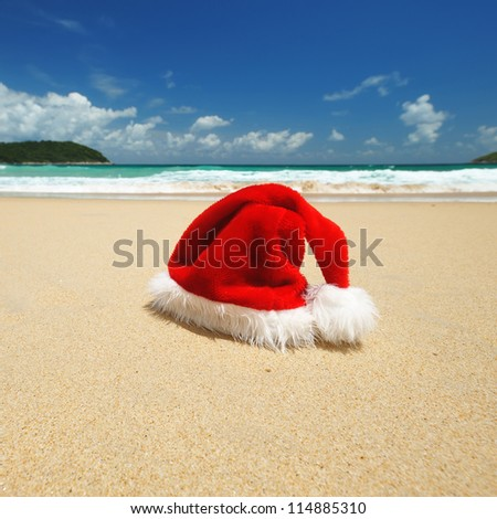 Santa's hat on a tropical beach - stock photo