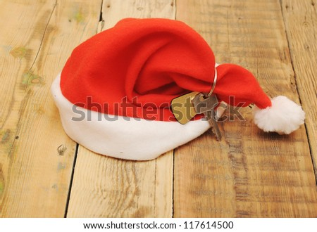 Santa's key with blank label  on old wooden table - stock photo