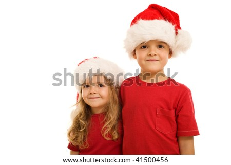 Santa's little helpers - smiling kids in red wearing christmas hats, isolated - stock photo