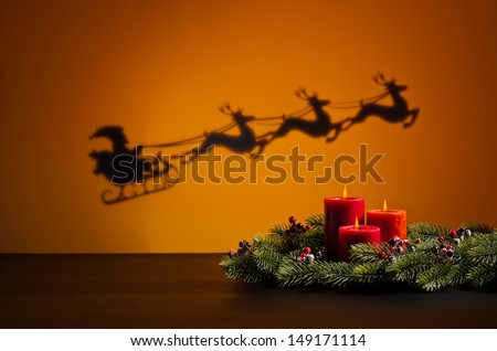 Santa's sledge on his way to deliver presents and candles - stock photo