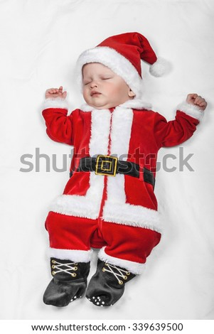 Santa sleeping newborn - stock photo