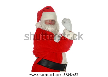 santa stands with his fist in the air isolated on white with room for your text - stock photo