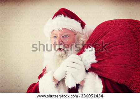 Santa takes care about his sack against room with wooden floor