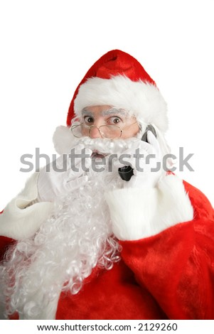 Santa talking on his cellphone with a surprised look on his face.  Isolated on white. - stock photo