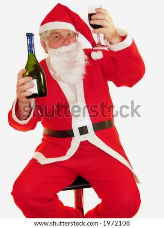 Santa toasting everyone at christmas - stock photo