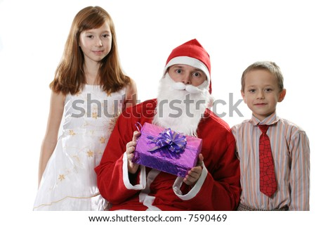 Santa together with two children and a gift on a white background - stock photo
