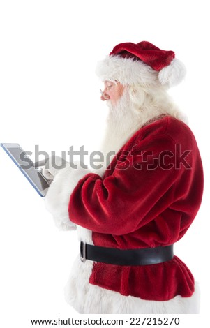 Santa uses a tablet PC on white background
