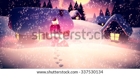 Santa with sack of gifts against santa flying over village at night - stock photo