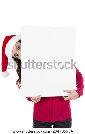 Santa woman looking from behind an advertisement poster with copy space