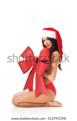 Santa woman sitting and covering her body by ribbon.
