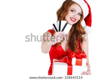 Santa woman with christmas gift box and credit cards. Portrait of beautiful woman in santa hat holding gift box and credit cards , isolated on white background. studio shot - stock photo
