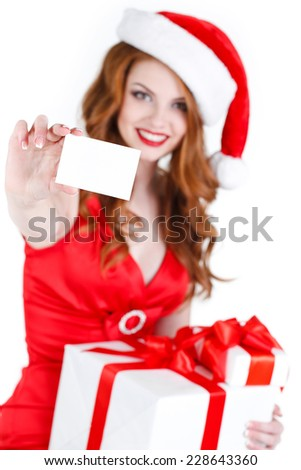 Santa woman with christmas gift box and white card. Portrait of beautiful woman in santa hat holding gift box and white card in hand , isolated on white background. studio shot - stock photo