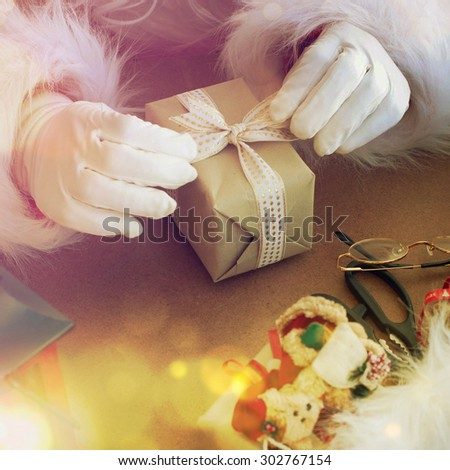 Santa wrapping presents