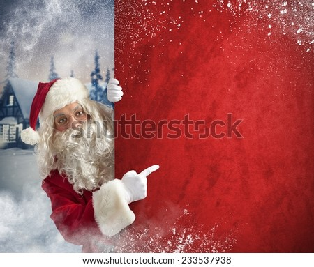 Santaclaus indicates billboard in a Christmas landscape - stock photo