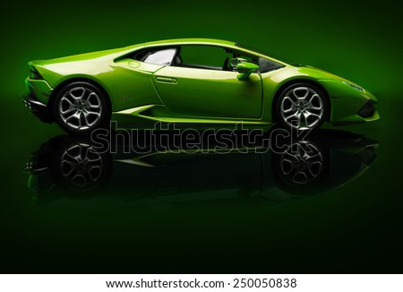 SANTAGATA BOLOGNESE, BOLOGNA, ITALY - JAN 20 - Toy lamborghini huracan on  green background, Tuesday 20 January 2015 - stock photo