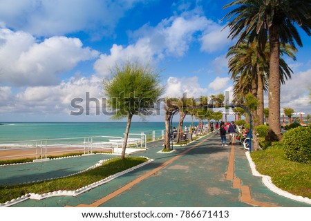 Santander,Spain - July 1, 2017: El Sardinero waterfront promenade and surfer beach. El Sardinero is a popular beach located in the Spanish city of Santander, Cantabria