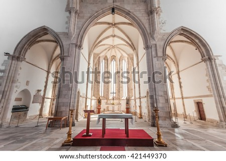 Santarem, Portugal. September 11, 2015: Altar, apse and chapels of the Santo Agostinho da Graca church. 14th and 15th century Mendicant and Flamboyant Gothic Architecture.  - stock photo