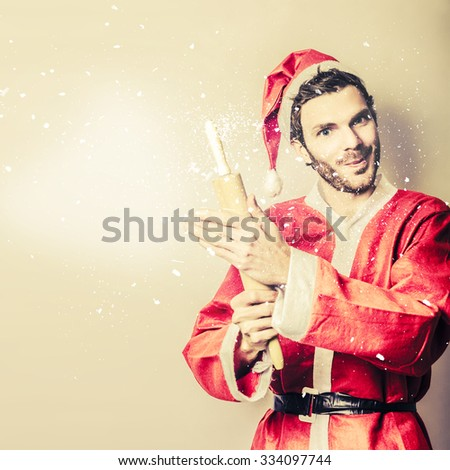 Santas little helper making a quick baking treat while whipping up a doughy mess with flour and rolling pin. Cooking with christmas tradition - stock photo